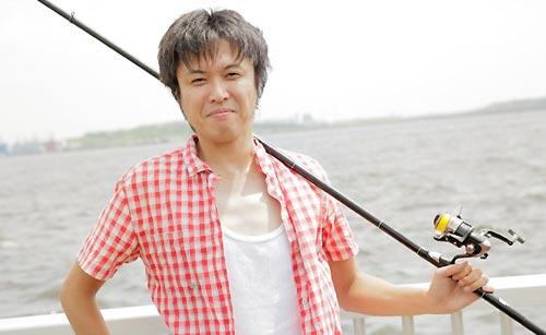 釣竿を持った漁師