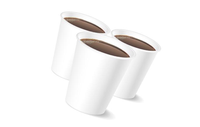 紙コップに入れたコーヒー