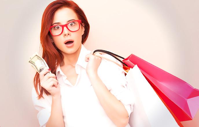 ブランド物を買う女