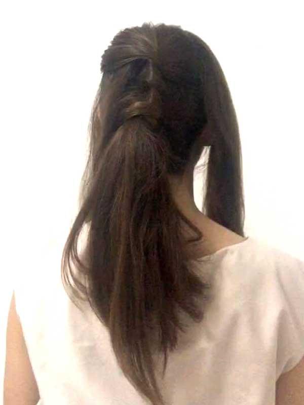 髪を3パートに三つ編みして巻きつけた女性の髪の毛