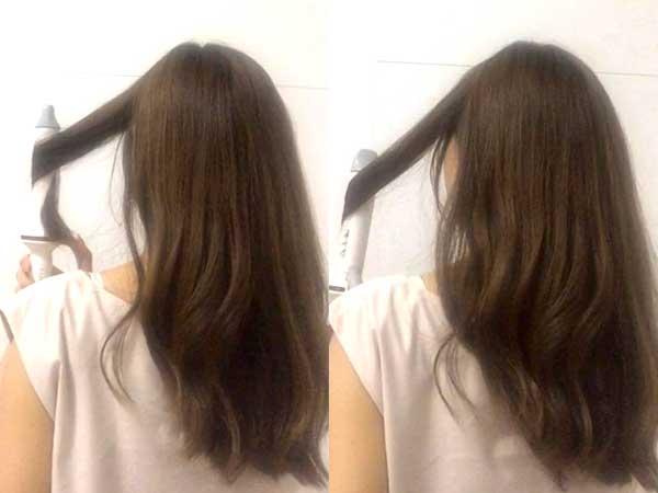 髪をコテで内巻きにしている女性